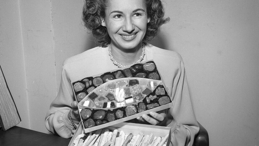 June 4, 1947: Aurora Springer, a secretary from the Los Angeles district attorney's office, exhibits $40,000 worth of opium found concealed in a candy box. This photo appeared in the June 5, 1947, Los Angeles Times.