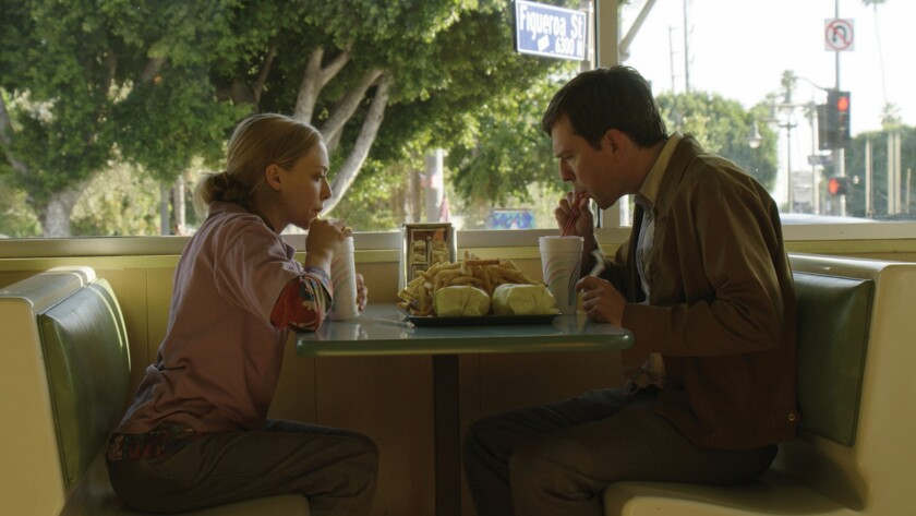 """(L-R) - Amanda Seyfried and Ed Helms in a scene from the movie """"The Clapper."""" Credit: Momentum Pictu"""