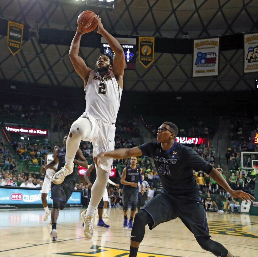 Baylor forward Rico Gathers (2), left scores over Kansas State forward Stephen Hurt (41), right, in the second half of an NCAA college basketball game, Saturday, Feb. 21, 2015, in Waco, Texas. Baylor won 69-42. (AP Photo/Rod Aydelotte)