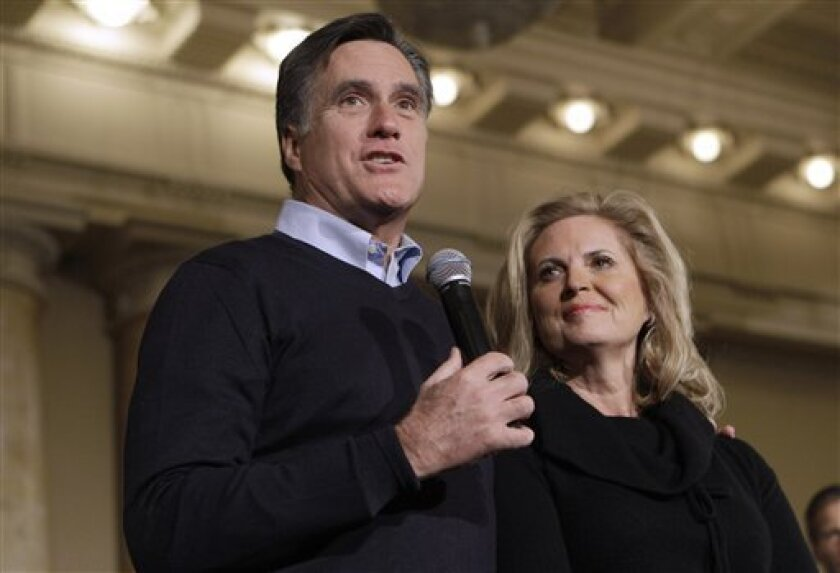 Republican presidential candidate, former Massachusetts Gov. Mitt Romney, accompanied by his wife Ann, speaks during a caucus day rally at the Temple for Performing Arts, Tuesday, Jan. 3, 2012, in Des Moines, Iowa. (AP Photo/Charlie Neibergall)