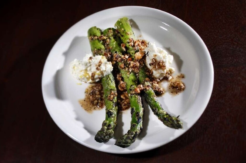 Fat Delta asparagus with Jersey cow's milk ricotta, pounded hazelnuts and lemon zest at Cooks County restaurant.