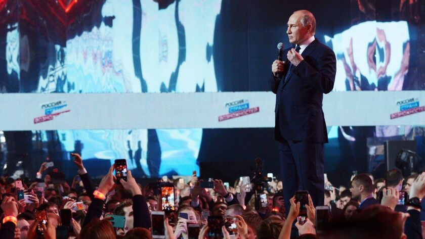 "Russian President Vladimir Putin speaks during the ""Russia, Land of Opportunity"" youth forum in Moscow on March 15."