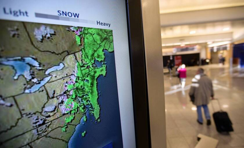 The most common exceptions used by insurers to reject travel insurance claims are illnesses involving a pre-existing medical condition, pregnancy or childbirth, losing a job or having a business meeting canceled, according to the National Consumer League. Above, a television screen shows the radar from a storm moving through the East Coast as passengers walk through Hartsfield-Jackson Atlanta International Airport last week.