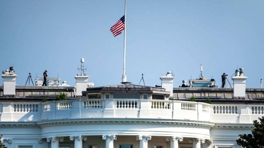 The U.S. flag flies at half-staff over the White House on Sunday. It was raised Monday.
