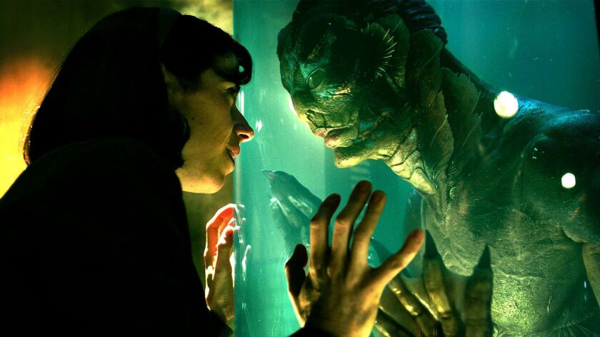 """(L-R) - Sally Hawkins and Doug Jones in the film """"THE SHAPE OF WATER."""" Credit: Fox Searchlight Pict"""