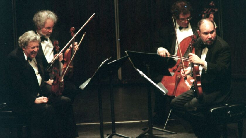Robert Mann (left front) has a laugh with the audience and Joel Smirnoff, violinists for teh Juillia