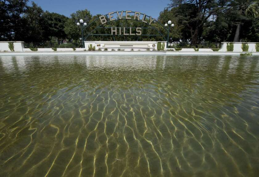 The Beverly Hills lily pond with the city's famous sign is seen on April 9. On average wealthier neighborhoods like Beverly Hills consume more water than less affluent ones, according to a study by researchers at UCLA.