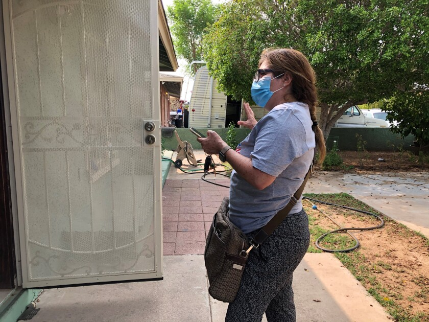 A volunteer canvasses door-to-door in Phoenix