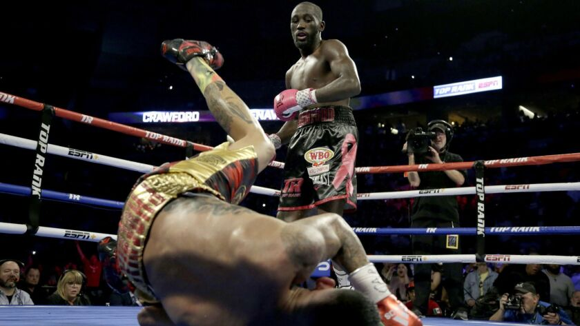 Terence Crawford watches as Jose Benavidez goes down in the 12th round.