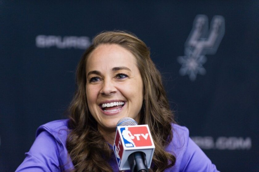 WNBA star Becky Hammon takes questions from the media at the San Antonio Spurs practice facility after being introduced as an assistant coach with the team on Tuesday, Aug. 5, 2014 in San Antonio. The San Antonio Spurs hired WNBA star Becky Hammon on Tuesday, making her the first full-time, paid fe