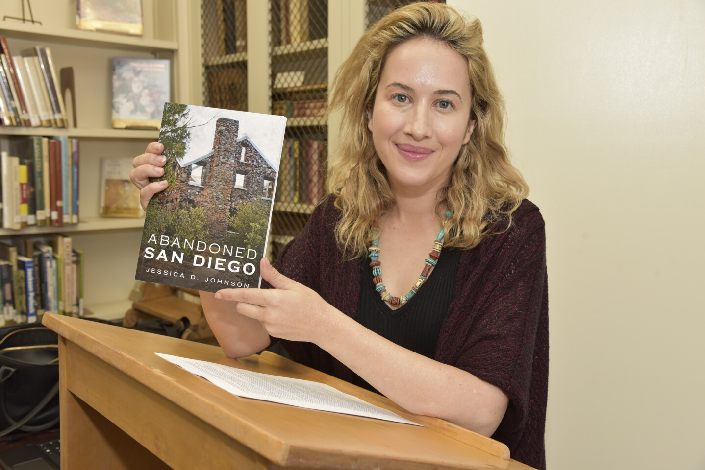 Author Jessica Johnson with her book, available at HiddenSanDiego.net