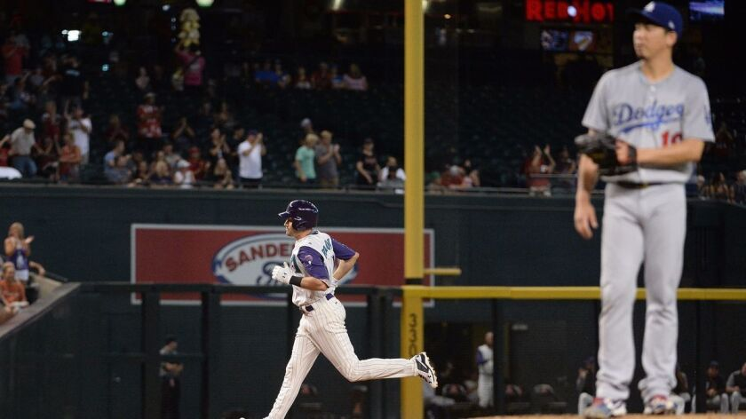 Arizona's A.J. Pollock rounds the bases after hitting a two-run home run against Dodgers pitcher Kenta Maeda in the third inning on Thursday in Phoenix.