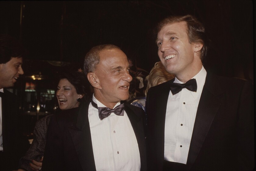 Roy Cohn, left, and Donald Trump at the 1983 opening of Trump Tower.