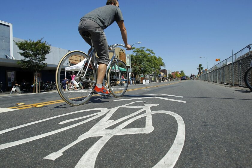Monday's approval of a plan to double San Diego's bicycle network follows a surge in bike events such as CicloSDias, (above) which opened city streets in August to bicyclists and pedestrians. UT-San Diego file photo.