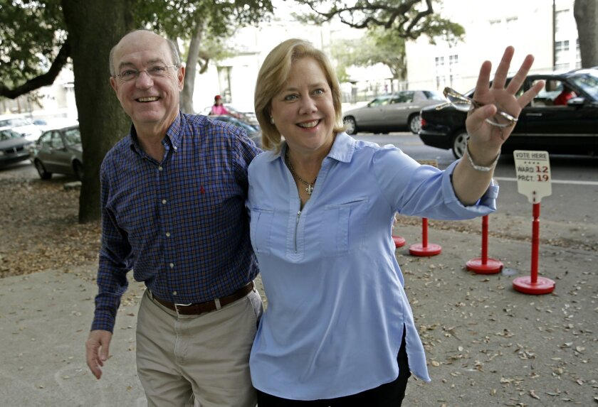 Sen. Mary Landrieu, D-La., arrives with her husband, Frank Snellings, to vote in her runoff election against Rep. Bill Cassidy, R-La., in New Orleans, Saturday, Dec. 6, 2014. (AP Photo/Gerald Herbert)