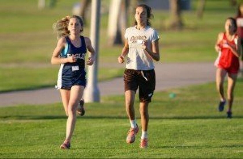 Elle Waters, left, won the girls South Coast Middle School League Championships in cross country at Mission Bay recently, along with her twin brother. Courtesy photo