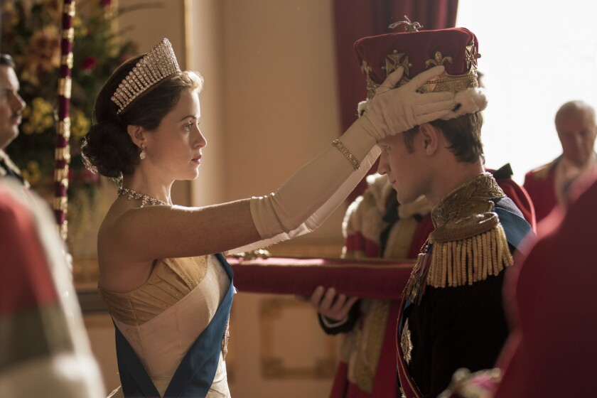 """Queen Elizabeth II (Claire Foy) formally makes Philip (Matt Smith) a British prince in Season 2 of Netflix's biographical drama """"The Crown."""""""