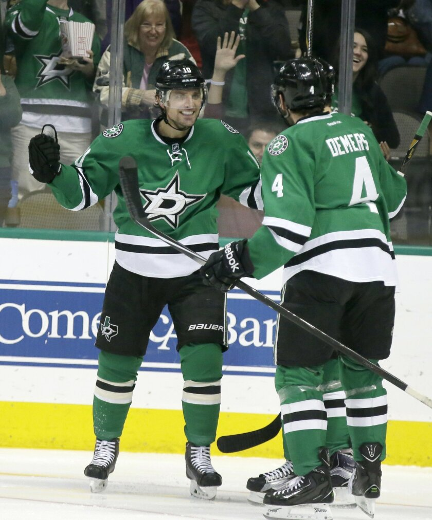 Dallas Stars left wing Patrick Sharp (10) celebrates his goals with teammate Jason Demers (4) during the first period of an NHL hockey game Saturday, Oct. 31, 2015, in Dallas. (AP Photo/LM Otero)