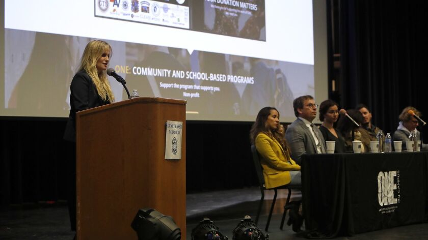 "Lynne Pedersen, left, One-On-Campus founder, speaks during a One-On-Campus ""awareness"" panel Wednesd"