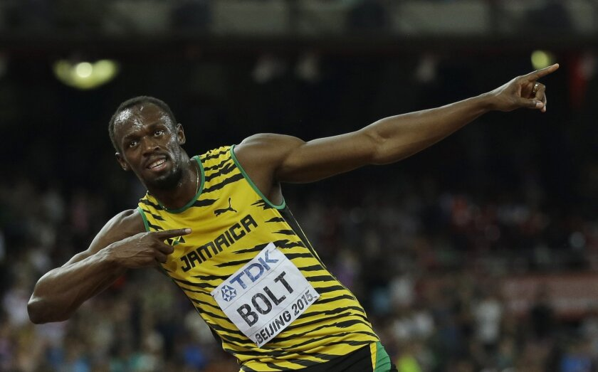 Jamaica's Usain Bolt celebrates after winning the men's 100m final at the World Athletics Championships at the Bird's Nest stadium in Beijing, Sunday, Aug. 23, 2015. (AP Photo/David J. Phillip)