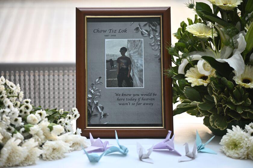 A photo of Alex Chow Tsz-lok is displayed at a makeshift memorial for him in Hong Kong.
