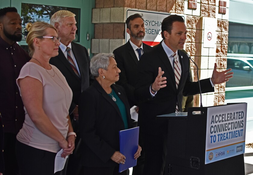 County supervisor Nathan Fletcher, backed by a group of county, city and nonprofit leaders, announces a new Accelerated Connections to Treatment program during a news conference on Wednesday, Feb. 26, 2020.