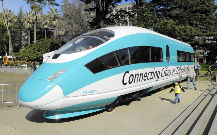 A full-scale mock-up of a high-speed train is displayed at the Capitol in Sacramento. Officials are confident they could navigate any pitfalls in the bullet train project.