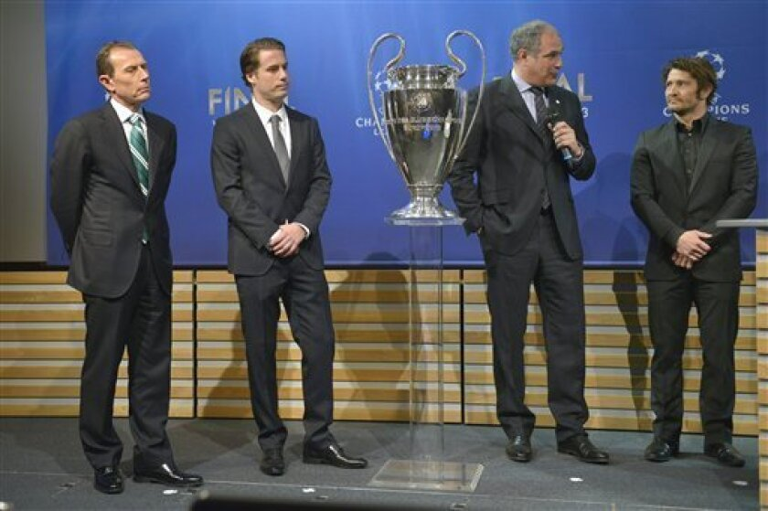 Real Madrid CF International Relations Director Emilio Butragueno, from left,  Borussia Dortmund former player Lars Ricken, FC Barcelona Director of Professional Football Andoni Zubizarreta  and FC Bayern Munich's former player Bixente Lizarazu, are seen during the draw of the games of the UEFA Cha