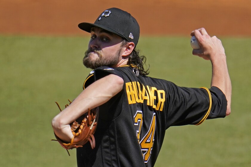 Pittsburgh Pirates pitcher JT Brubaker delivers during the first inning of a spring training exhibition baseball game against the New York Yankees in Tampa, Fla., Saturday, March 13, 2021. (AP Photo/Gene J. Puskar