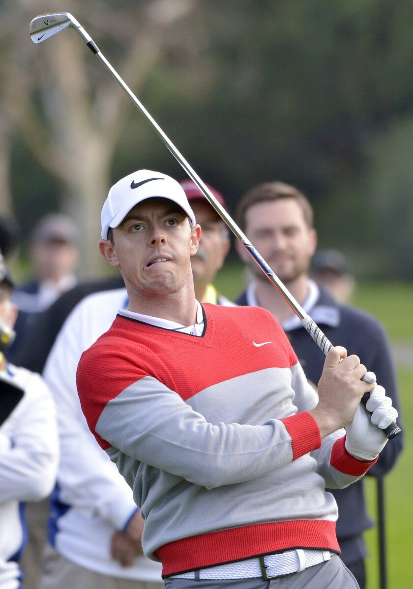 Rory McIlroy watches his shot from the rough on the 12th fairway during the first round of the Northern Trust Open golf tournament at Riviera Country Club on Thursday, Feb. 18, 2016, in Los Angeles.(John McCoy/Los Angeles Daily News via AP)