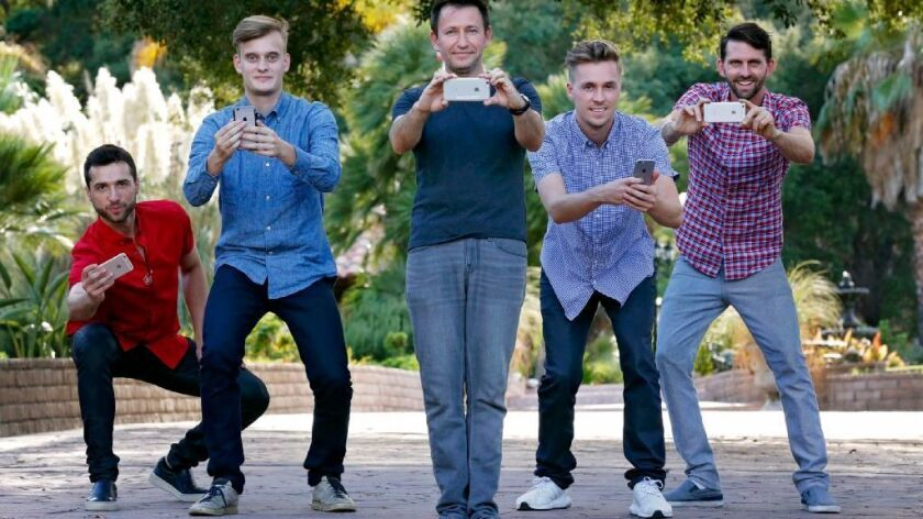 Dmitry Shapiro (center) and his GoMeta co-founders near Shapiro's Spring Valley home. The San Diego startup GoMeta is launching an augmented reality app called Metaverse that will be used in a splashy scavenger hunt Saturday in downtown San Diego.