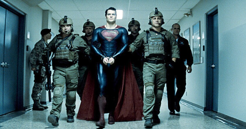 "Henry Cavill (center) as Superman and Christopher Meloni (far right) as Colonel Hardy in ""Man of Steel."""
