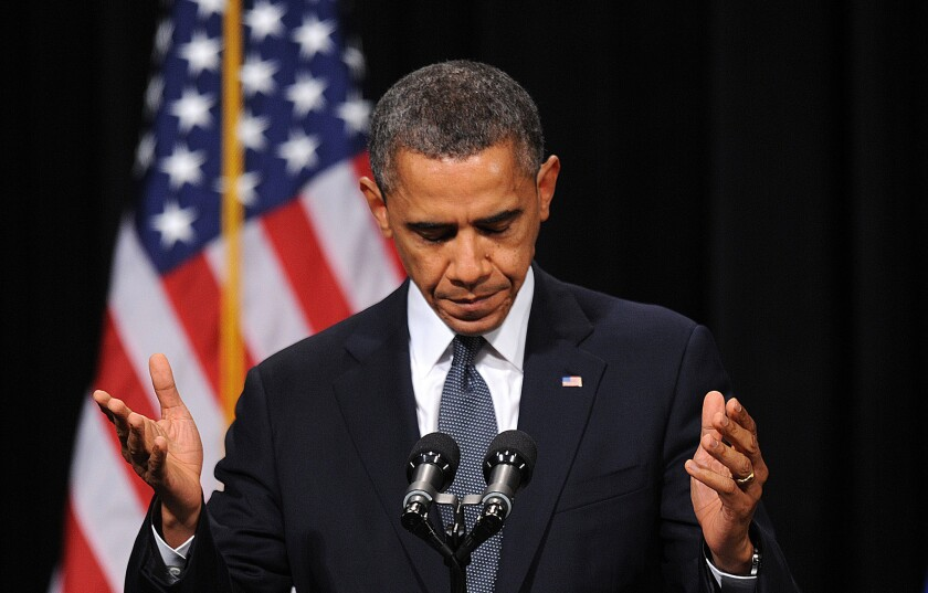 President Obama speaks at an interfaith vigil at Newtown High School for the shooting victims from Sandy Hook Elementary School.