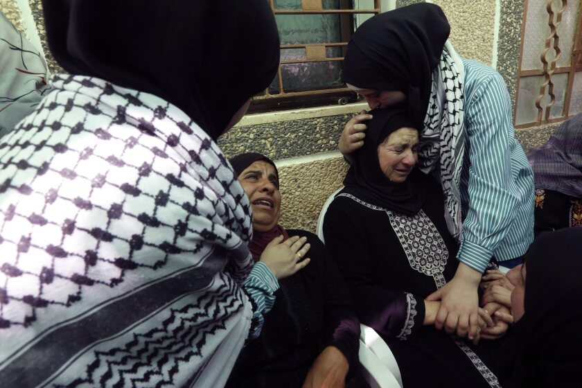 Palestinian women weep during the funeral of Riham Dawabshe in Duma village, near the West Bank city of Nablus, on Sept. 7, 2015.