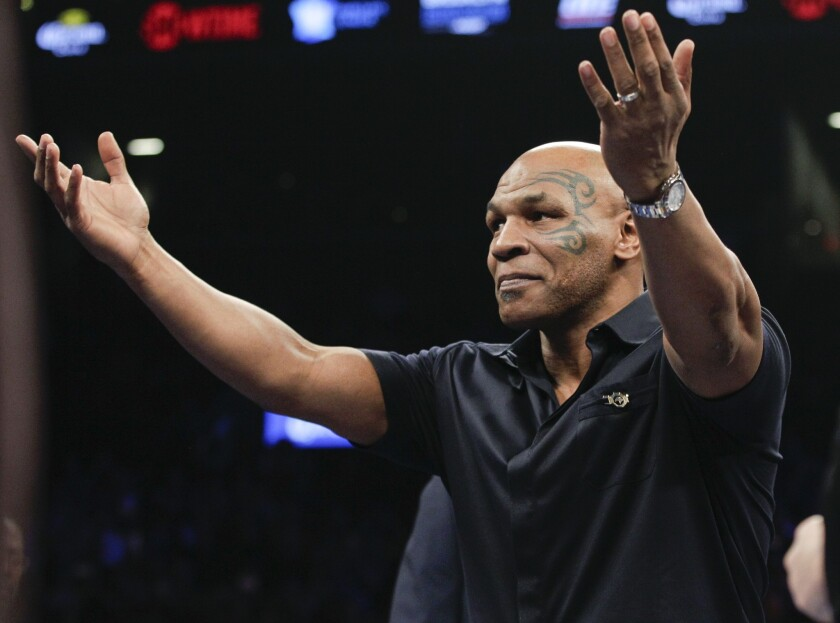 Former boxer Mike Tyson acknowledges the crowd before a WBC heavyweight title boxing match between Deontay Wilder and Artur Szpilka in New York on Jan. 16.
