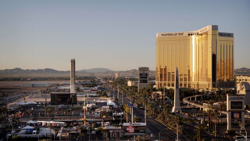 The Mandalay Bay resort and casino, right, overlooks an outdoor festival grounds across the street,