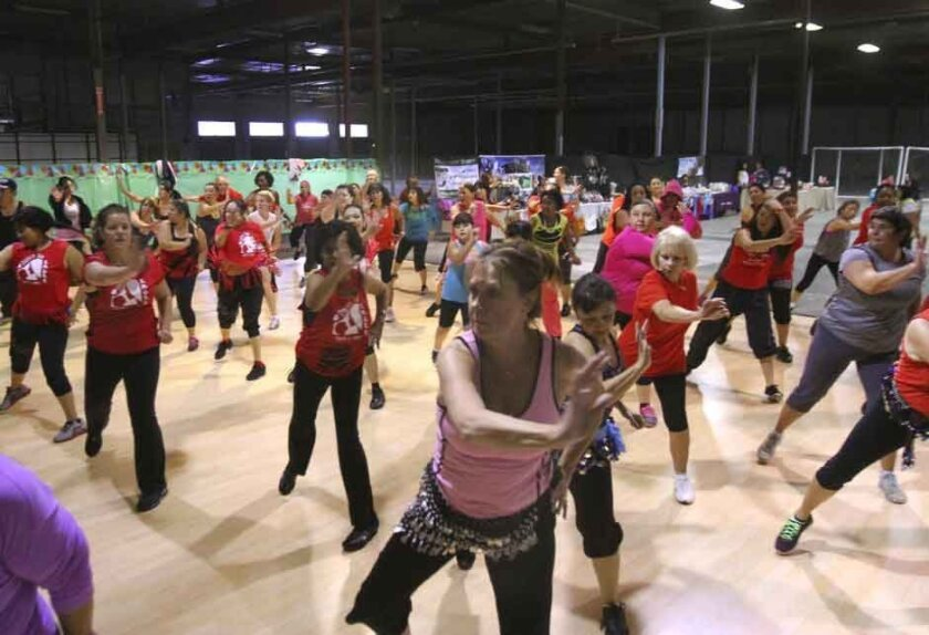 People do Zumba during the Zumbathon charity event at Odyssey Arts & Entertainment in Temecula. Proceeds from the event went to SMURF a support group for single mothers.