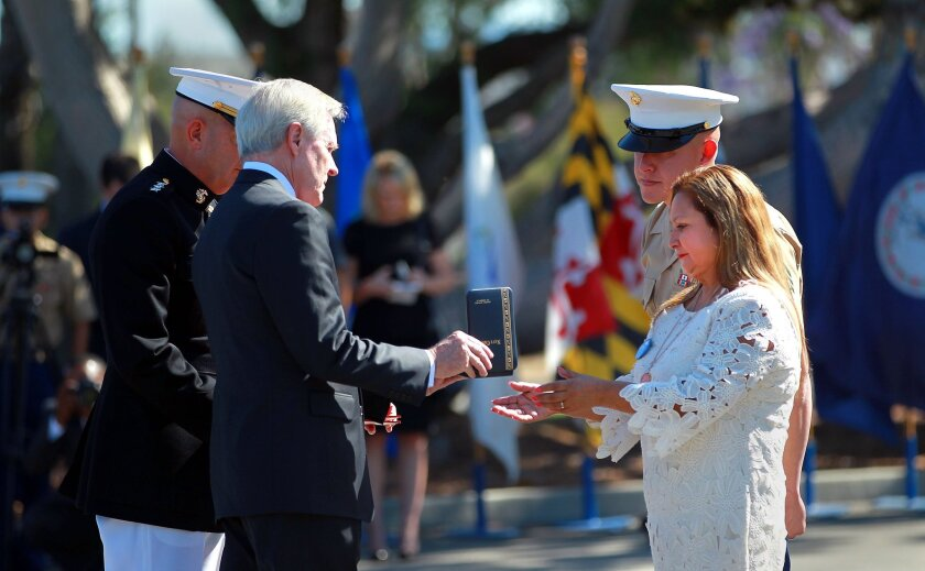 Mrs. Rosa Peralta, mother of Sgt. Rafael Peralta, USMC, right, accepts the Navy Cross presented to her for her son's actions by Navy Secretary Ray Mabus at Camp Pendleton Monday morning.