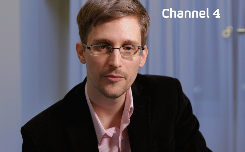 An undated handout file picture received Dec. 24 shows U.S. intelligence leaker Edward Snowden preparing to make his Christmas statement on television.