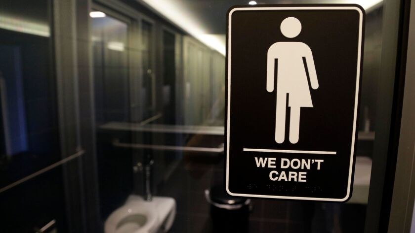 A sign indicating a gender-neutral bathroom is seen at the 21c Museum Hotel in Durham, N.C., on May
