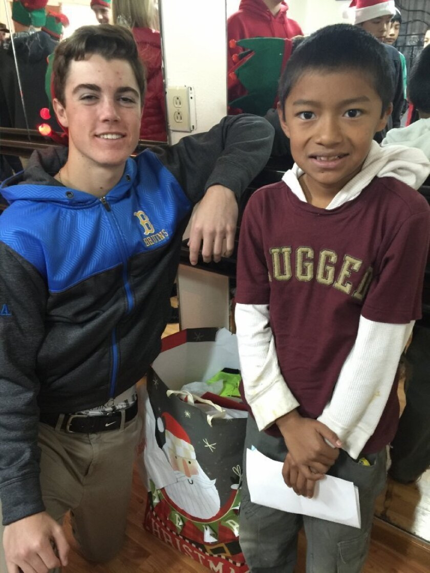 "Jake Connelly and his ""Build a Miracle Buddy"" Alex."