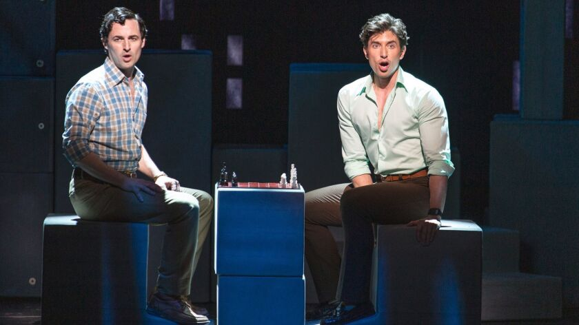 """Home life can be a bit of a chess game as lovers Marvin (Max von Essen, left) and Whizzer (Nick Adams) jostle for power in """"Falsettos."""""""
