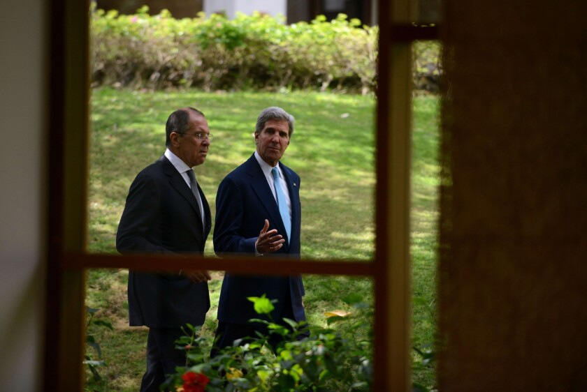 Secretary of State John Kerry, right, walks with Russian Foreign Minister Sergei Lavrov to a news conference at the Asia-Pacific Economic Cooperation summit in Nusa Dua on Indonesia's resort island of Bali.