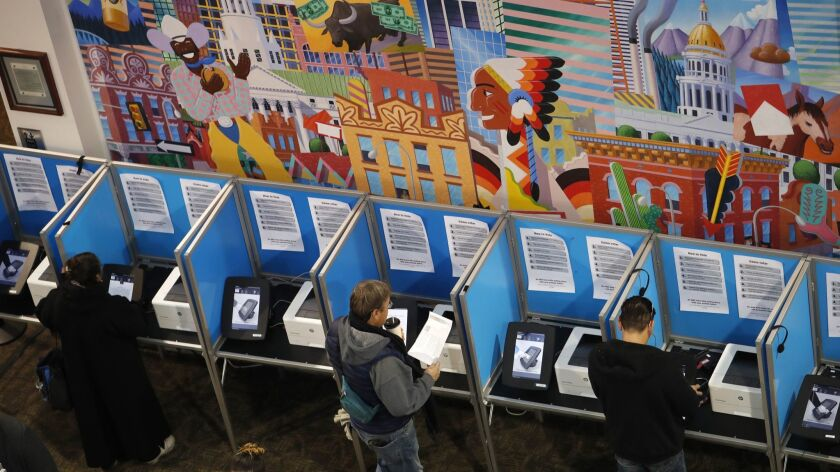 A Denver polling place in 2018. Colorado's Democratic-controlled Legislature has approved a bill to join other states in casting their presidential electoral votes for the winner of the national popular vote.
