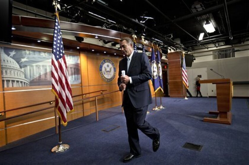 """House Speaker John Boehner, R-Ohio, leaves a news conference after telling reporters that the looming sequester and resulting budget cuts would be like """"taking a meat ax to our government,"""" at the Capitol in Washington, Wednesday, Feb. 6, 2013. Eager to buy time and avoid economic pain, President B"""