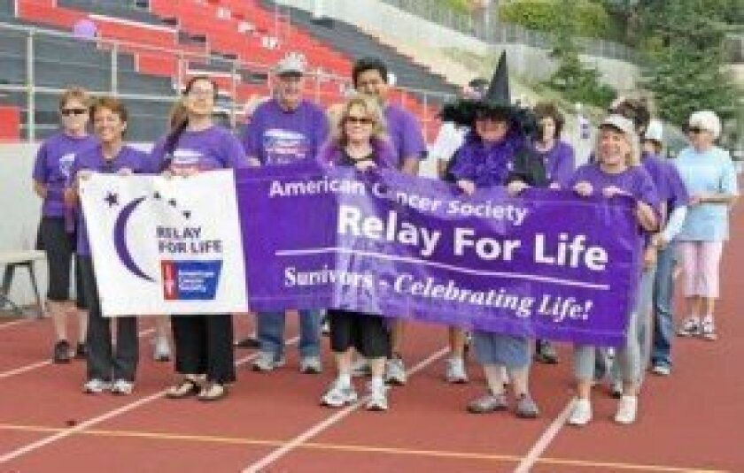 After the survivor lap, participants start the 24 hours of walking at the 2012 Relay.
