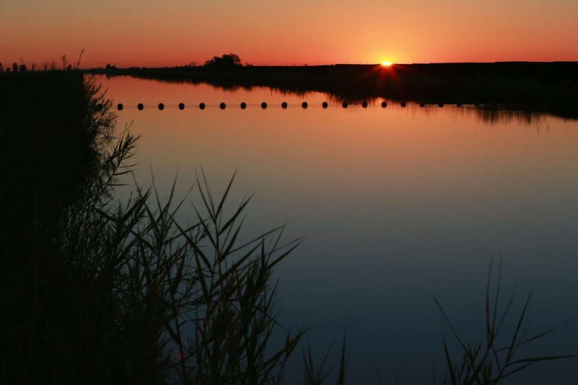 Sunrise on the All-American Canal in Imperial County. Improvements to the canal were an important part of the Imperial-to-San Diego water transfer agreement 10 years ago.