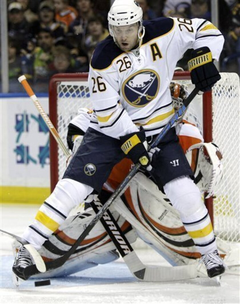Buffalo Sabres' Thomas Vanek (26), of Austria, redirects the puck in front of Philadelphia Flyers goalie Sergei Bobrovsky, of Russia, during the first period of an NHL hockey game in Buffalo, N.Y., Friday, April 8, 2011. (AP Photo/David Duprey)