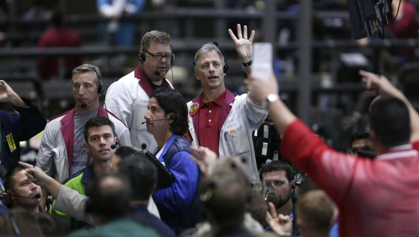 In this Sept. 24, 2014 photo, traders work in the ten-year bond pit on the floor of the CME Group in Chicago. Main Street investors have poured a trillion dollars into bonds since the financial crisis, and helped send prices soaring. As fund managers and regulators fret about an inevitable sell-off, the bigger fear is that when people go to unload, there won't be anyone to buy. (AP Photo/M. Spencer Green)