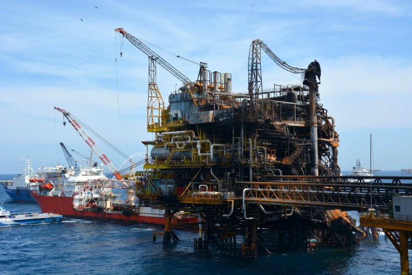 In this Thursday April 2, 2015, handout  photo provided by Petroleos Mexicanos (Pemex), emergency boats works to put out a fire at the Abkatun-A Permanente shallow-water oil platform in the Campeche Sound. Three workers are missing following the huge blaze on the platform in the Gulf of Mexico that